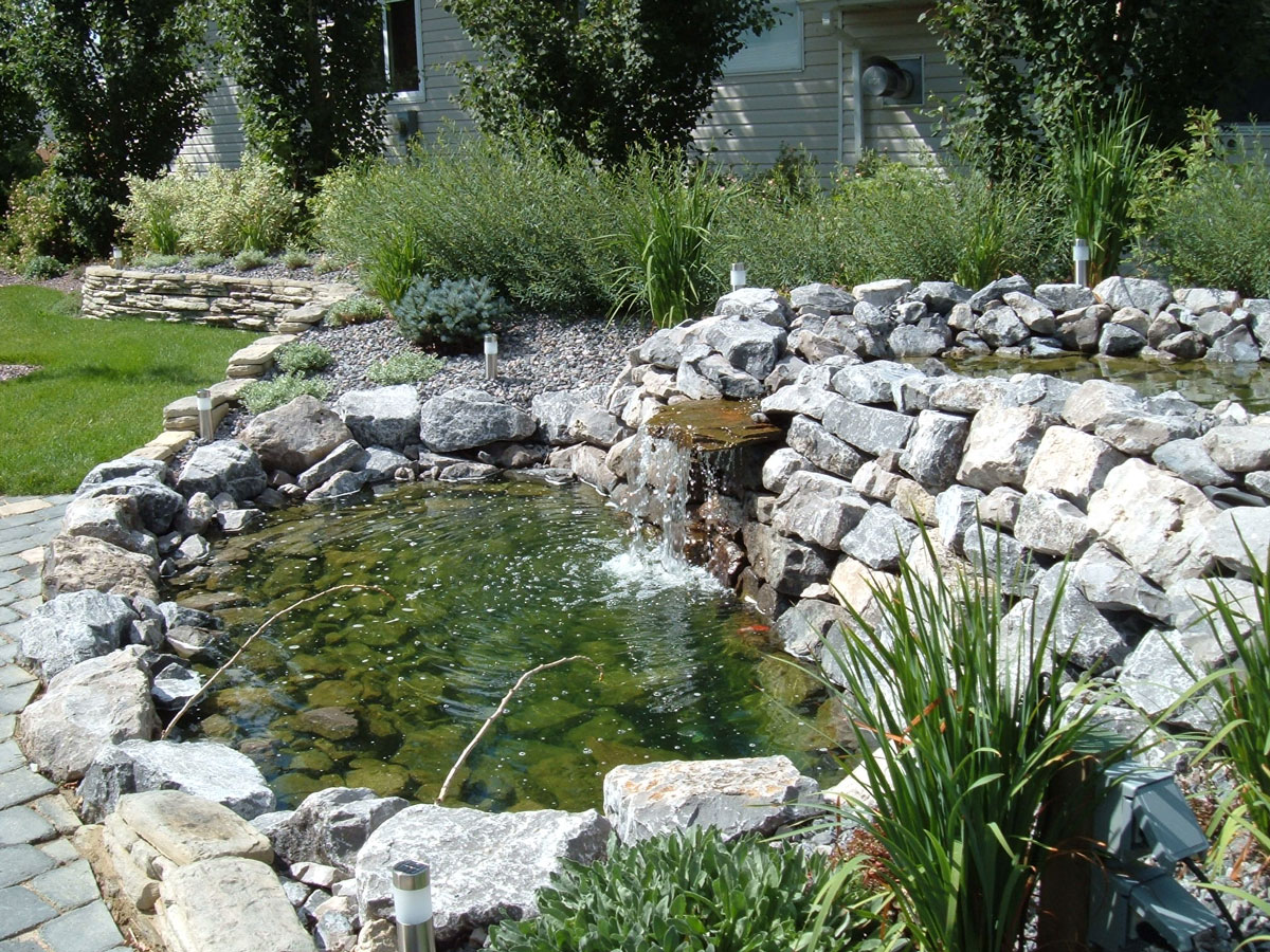 Waterfalls ponds and rain gardens creative landscape for Creative landscape design