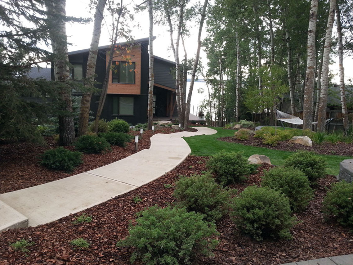 Lakeside Cottage With A Winding Sidewalk Through The Yard To The Front  Door. Trees,