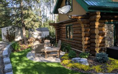 A rock wall creates a level area for a patio and perennials beds in the front yard