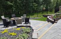 Rock Walls, Garden Stairs and Patio has turned this sloped yard into an enjoyable garden. Barkman Bridgewood Slabs adds a wooden texture to the patio.