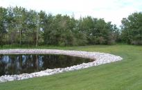 Pond with limestone rip-rap