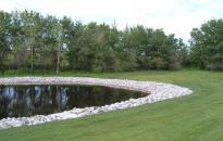 Pond with limestone rip-rap