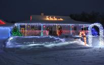 House and yard lit up for Christmas welcomes you home