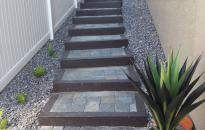 Paving stone steps provide a nice access along the side yard.